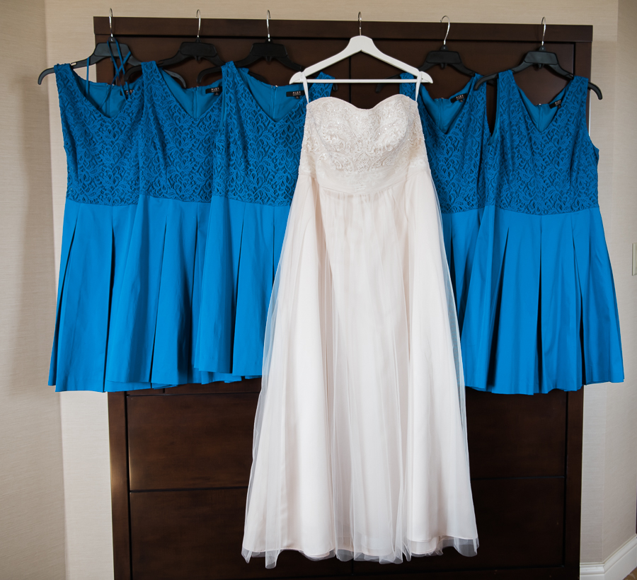 Wedding dress with bridesmaid dresses blue