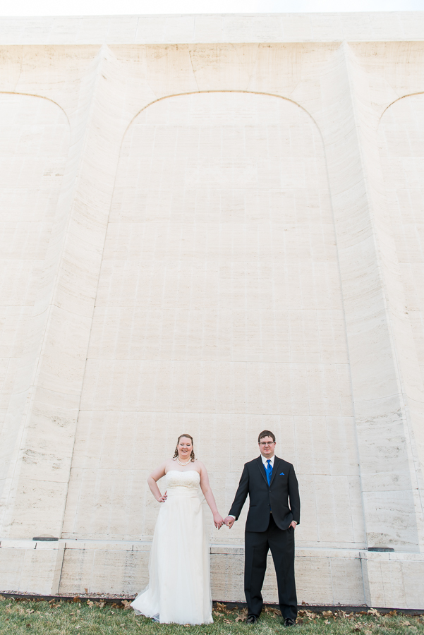 Couple portraits with white wall